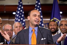-                FILE - In this Aug. 2, 2012 file photo, Rep. Luis Gutierrez, D-Ill., center, accompanied by fellow House members, speaks during a news conference on Capitol Hill in Washington.  House m