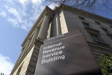 -                FILE - This March 22, 2013 file photo shows the exterior of the Internal Revenue Service building in Washington. No one answered the phone at the IRS hotline for tax help. Forget about