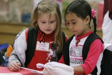 -                Classmates and survivors from Plaza Towers Elementary School Elizabeth Anderson, 6, left, and Rylee Pino, 6, read messages from other children in the area during a visit to Eastlake Ele