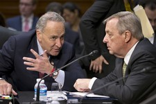 -                FILE – In this May 20, 2013, file photo Senate Judiciary Committee members Sen. Chuck Schumer, D-N.Y., left, and Sen. Richard Durbin, D-Ill., confer on Capitol Hill in Washington as the