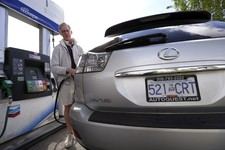 -                In this Thursday, May 23, 2013 photo, Curt Griffiths, from nearby White Rock, British Columbia, pumps gas at a station in Blaine, Wash. In April 2013, in its 2014 fiscal year budget pro