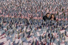 -                A couple photograph themselves amongst a sea of flags on Boston Common in Boston, Sunday, May 26, 2013. The flags were placed by the  Massachusetts Military Heroes Fund in memory of eve
