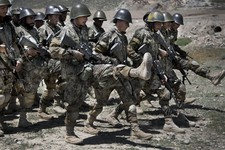 -                Afghan Army soldiers march during a practice session at a training facility in the outskirts of Kabul, Afghanistan on Wednesday, May 8, 2013. In roughly 90 percent of the country, Afgha
