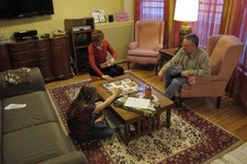 "-                ADVANCE FOR USE TUESDAY, MAY 28, 2013 AND THEREAFTER - Ryan, a ""gender variant"" fourth grader, plays a board game with her parents Sabrina and Chris at their home in Illinois on Wednesd"