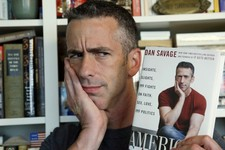 "-                In this photo taken on May 22, 2013, author Dan Savage is in his home in Seattle. Savage's latest book, ""American Savage,"" was released on Tuesday, May 28. (AP Photo/Elaine Thompson)"