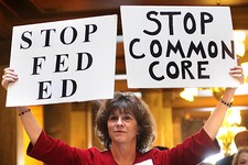 -                In this Jan. 16, 2013 file photo, concerned grandparent Sue Lile, of Carmel, Ind., shows her opposition to Common Core standards during a rally at the State House rotunda in Indianapoli