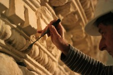 -                A restorer at the Israel Museum works on a reassembled display of what curators say was Herod's tomb in the Israeli museum, Jerusalem, Tuesday, Jan. 15, 2012. Israel's national museum i