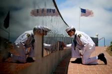 -                AP10ThingsToSee - Sea Cadet Andrew Culp, 13, cleans a war memorial during a Memorial Day ceremony at the Mount Soledad Veteran's Memorial in La Jolla, Calif., Monday, May 27, 2013. (AP