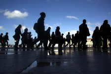 -                Commuters walk along Comercio square during a 24-hour Lisbon's subway workers strike, Thursday, May 30, 2013. The strike snarled rush-hour traffic in the Portuguese capital in the lates