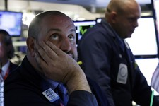 -                FILE - In this Wednesday, May 29, 2013, file photo, Specialist Peter Giacchi, left, works on the floor of the New York Stock Exchange. Banks and utility companies led stocks higher in m