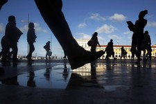 -                Commuters walk along Comercio square during a 24-hour subway workers strike, Lisbon, Thursday, May 30, 2013. The strike snarled rush-hour traffic in the Portuguese capital in the latest
