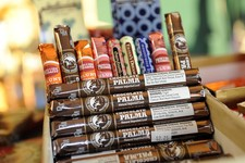 -                Candy-flavored cigars appear on display at a custom tobacco shop in Albany, N.Y., Friday, May 31, 2013. The American Cancer Society is pushing to make New York the first state to enact