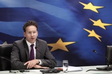 -                Jeroen Dijsselbloem, who heads the finance ministers of the 17 European Union countries that use the euro, answers questions during a  join news conference with Greek Finance Minister