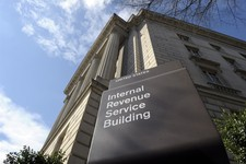 -                FILE - This March 22, 2103 file photo shows the exterior of the Internal Revenue Service building in Washington. For a time, the Internal Revenue Service inspired awe and admiration in