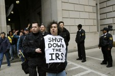 -                FILE - This March 19, 2008 file photo shows an Iraq War demonstrator gets arrested outside the Internal Revenue Service (IRS) in Washington during a protest on the fifth anniversary of