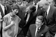 -                FILE- In this July 17, 1984 file photo, President Ronald Reagan, seated, signs legislation raising the national drinking age to 21 while New Jersey Republican Sen. Frank Lautenberg,  ce