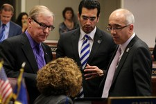 -                Nevada Senate Democrats, from left, David Parks, Debbie Smith, Ruben Kihuen and Mo Denis talk on the Senate floor during the final minutes of the 77th Legislative session in Carson City