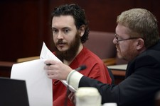 -                Defense Attorney Daniel King, right, and  Aurora theater shooting suspect James Holmes review advisement documents in court in Centennial, Colo., on Tuesday, June 4, 2013. Holmes was al