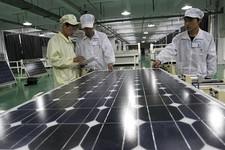 -                File - In this Wednesday March 21, 2012 file photo,  Chinese workers examine solar panels at a manufacturer of photovoltaic products in Huaibei in central China's Anhui province. The Eu