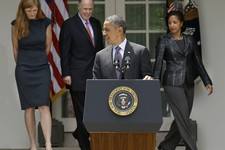 -                President Barack Obama waits at the podium in the Rose Garden of the White House in Washington. Wednesday, June 5, 2013, for, from left,  Samantha Power, his nominee to be the next UN A
