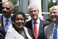 -                Former President Bill Clinton, second from right, stands with, from left, Attorney General Eric Holder, Myrlie Evers-Williams, the widow of slain civil rights activist Medgar Evers, and