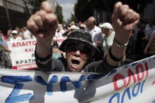 -                An elderly woman chants anti-austerity slogans during a protest by hundreds of pensioners in central Athens, Thursday, June 6, 2013. Elderly Greeks have faced successive pension cuts si