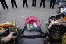 -                Bosnian women and their babies protest in front of the Bosnian parliament building in Sarajevo, Thursday, June 6, 2013. Nearly 3,000 people formed a chain around Bosnia's parliament Thu