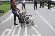 -                Bosnian woman Selma Zatega , with her baby Luna  takes part protest in front of the Bosnian parliament building in  Sarajevo, on Wednesday, June 5, 2013. Dozens of people are blocking t
