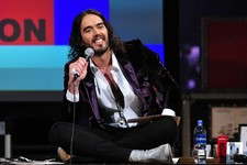 "-                This March 14, 2013 photo released by FX shows Russell Brand, host of the FX series ""Brand X with Russell Brand."" The British comedian announced Thursday, June 6, that he's launching a"