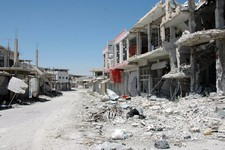 -                FILE -- In this June 5, 2013 file photo released, by the Syrian official news agency SANA, a damaged street is seen in Qusair, Syria. Syria's civil war has morphed into a proxy fight in