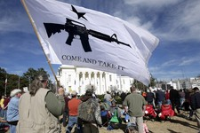 -                FILE – In this Jan. 19, 2013 file photo  James Wilson of Elmore, Ala., left, rallies against gun control during a demonstration at the State Capitol in Montgomery, Ala. Exactly how you