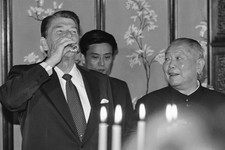 -                FILE - In this April 26, 1984, file photo, Chinese President Li Xiannian, right, grins as he watches President Ronald Reagan drink Maotai during a toast in Peking. (AP Photo/Scott Stewa
