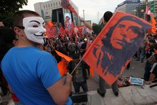 -                Turkish protesters wave posters of revolutionary legend Che Guevara as they gather at the city's main Kizilay Square in Ankara, Turkey, Saturday, June 8, 2013. Turkey's Prime Minister R