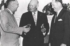 -                This undated image provided by NASA shows President Dwight Eisenhower, center, commissioning Dr. T. Keith Glennan, right, as the first administrator for NASA and Dr. Hugh L. Dryden as d