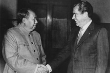 -                FILE - In this Feb. 21, 1972, file photo, Chinese communist party leader Mao Tse-Tung, left, and U.S. President Richard Nixon shake hands as they meet in Beijing. Nixon's visit marked t