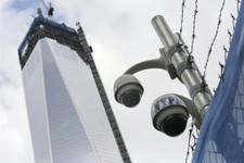 -                FILE- In this Monday, Feb. 25, 2013, file photo, New York Police Department security cameras are in place at the National September 11 Memorial and Museum, in New York. Since Sept. 11,