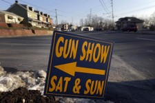 -                FILE - In a Friday, Jan. 4, 2013 file photo, a sign is posted for an upcoming gun show, in Leesport, Pa. Nearly six in 10 Americans want stricter gun laws in the aftermath of last month