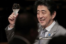 -                FILE - In this June 2, 2013 file photo, Japanese Prime Minister Shinzo Abe raises a glass for a toast during the official dinner with African leaders hosted by Abe at the Tokyo Internat