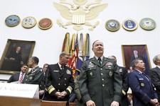-                FILE - In this Sept. 23, 2010, file photo Army Gen. Keith B. Alexander, then-commander of the U.S. Cyber Command, center right, arrives at a Capitol Hill committee hearing in Washington