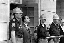 -                FILE - In this June 11, 1963 file photo, Gov. George Wallace blocks the entrance to the University of Alabama as he turned back a federal officer attempting to enroll two black students
