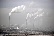 -                FILE - In this Dec. 3, 2009 file photo smoke billows from chimneys of the cooling towers of a coal-fired power plant in Dadong, Shanxi province, China. The International Energy Agency s