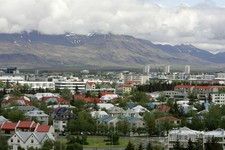 -                FILE - In this Saturday, May 31, 2008 file photo, a view across Reykjavík in Iceland from Öskjuhlíd Hill. In recent years the country has welcomed eccentric chess master Bobby Fischer,