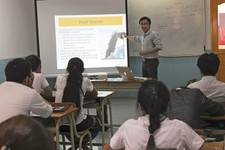 -                In this Nov. 18, 2012 photo released on June 7, 2013 by Chen Mei, a Laotian teacher instructs the first class of students environmental studies in a classroom at the transitional campus