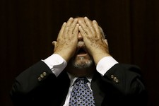 -                Rep. Macario Saldate, D-Tucson, rubs his eyes during a special session budget battle for Medicaid funding on Wednesday, June 12, 2013, in Phoenix.  The Arizona Legislature is on track t