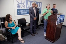 -                Surrounded by attorneys, James Brown, second from right, talks during a news conference, Wednesday, June 12, 2013, at the ACLU headquarters in Las Vegas, about currently living with his