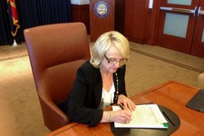 -                In this photo provided by by Ariz. Rep. Jeff Dial, Gov. Jan Brewer signs a proclamation calling the Legislature into special session, Tuesday, June 11, 2013, in Phoenix. Brewer acted af