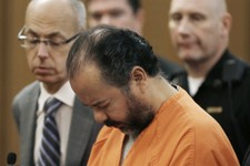 -                Ariel Castro stands before a judge during his arraignment Wednesday, June 12, 2013, in Cleveland.  Castro, 52, is accused of holding three women captive in his Cleveland home for about