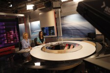 -                Greek state television presenters Stavroula Christofilea, left, and Chrysa Roumelioti present a news bulletin broadcast through the internet in the studio of ERT headquarters during a 2