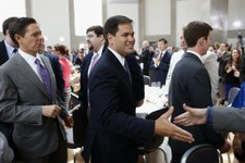 "-                Sen. Marco Rubio, R-Fla., center, greets attendees as he is followed by Ralph Reed, founder of the Faith and Freedom Coalition, left, after he spoke at the ""Road to Majority"" conference"