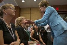 -                Teresa Rousseau, mother of Lauren Rousseau, is greeted by House Minority Leader Nancy Pelosi of Calif., right, during a news conference on Capitol Hill in Washington, Thursday, June 13,